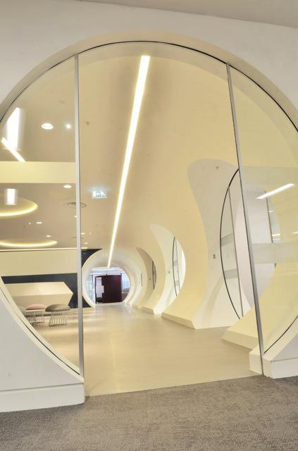 Corian Glacier White tunnel @ bwin.party - Designed by Ranne Creative Interiors