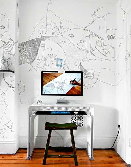 Minimal desk with wall art.