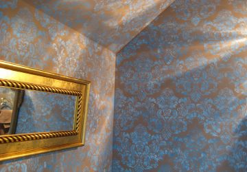 Blue stencilled wall - Photo by PoshSurfside.com
