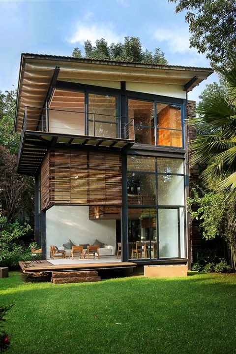 Modern home exterior with wooden features and large windows