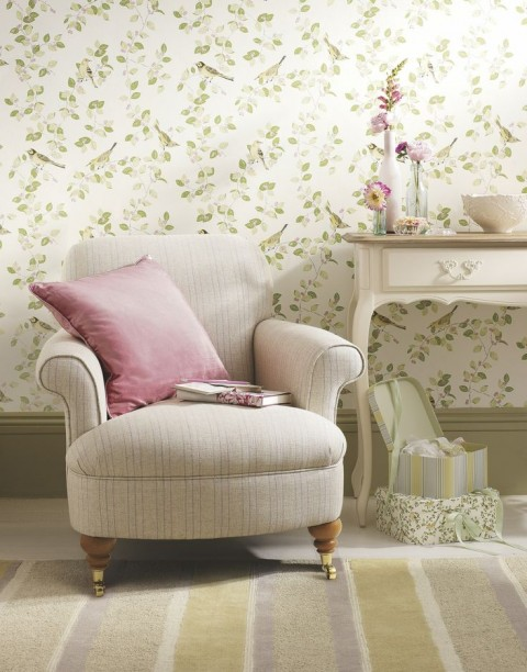 Chair and table with floral wallpaper background