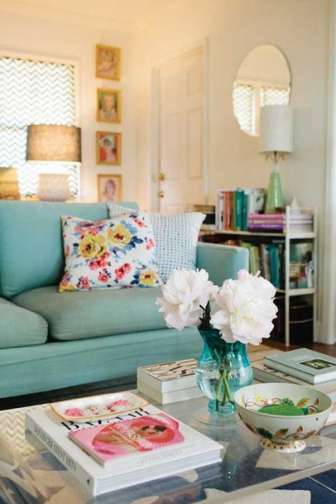 Green sofa with white flowers & floral cushion