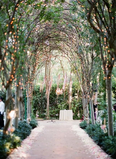 Tree arches wedding aisle