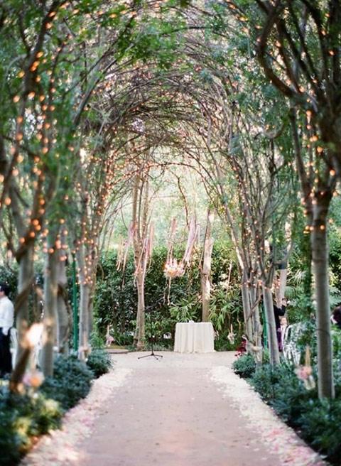 Tree arches wedding aisle