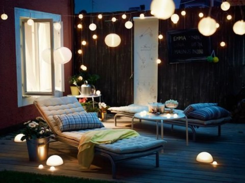 Patio with chairs, lights and decking