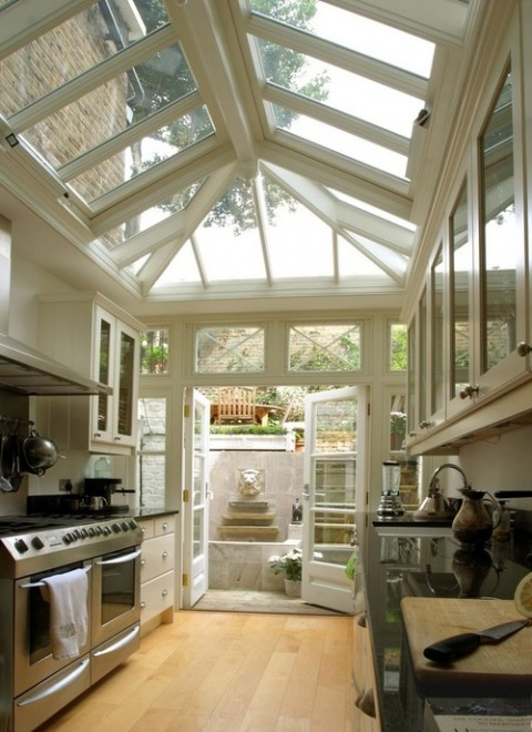 Kitchen and conservatory - Photo found on homedit.com