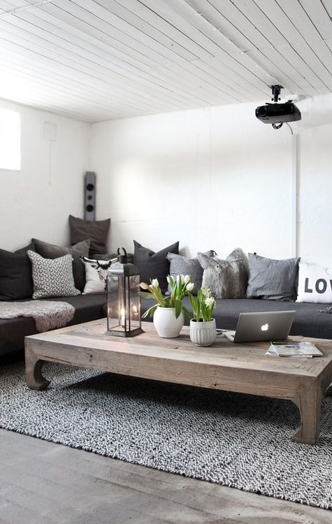 L-shape sofa and a huge designer coffee table