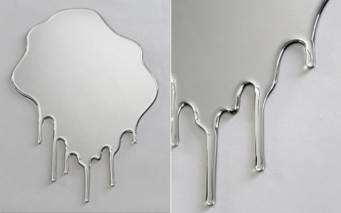 Unusual dripping mirror centerpiece