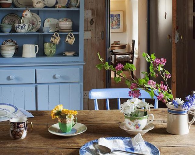 Cottage Country Kitchen With Blue Dresser & Wooden Table
