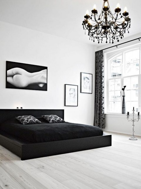 Modern Black and White Bedroom With Black Chandelier