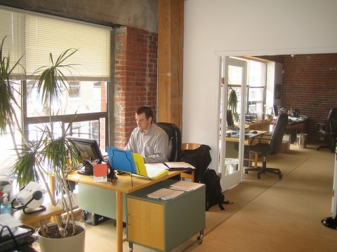 Benefits Of Serviced Offices In The City - Man Sat At Desk In Office.