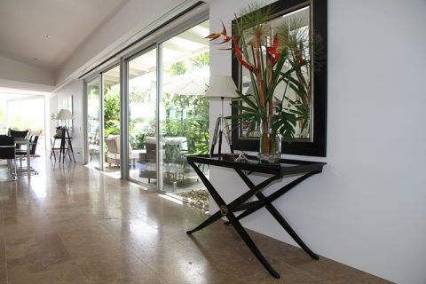 How Concrete Flooring Can Help You Achieve The Minimalist Look - Flower Display Adding Colour