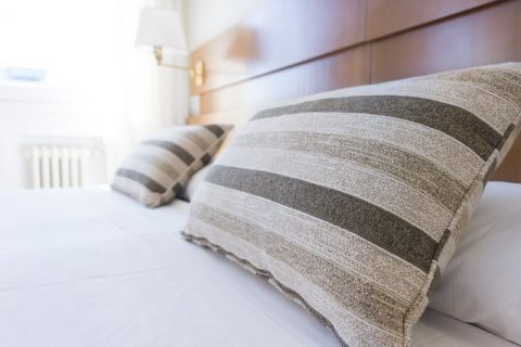 How Concrete Flooring Can Help You Achieve The Minimalist Look - Neutral Bedding.