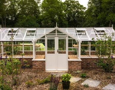 7 Tips To Keep Your Garden Lush, Healthy, Green, and Beautiful in Summer - Swallow Swan 8x34 Wooden Greenhouse - Image Via greenhousestores.co.uk