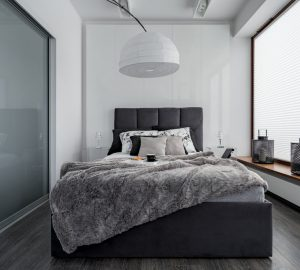 Gray and white bedroom with double bed, modern lamp and sliding door wardrobe