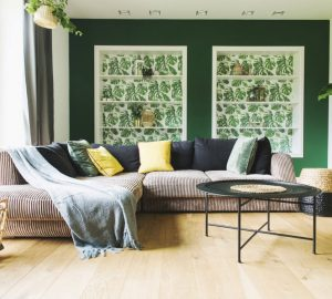 Living Room, Green Painted Walls. Plants Corner Sofa