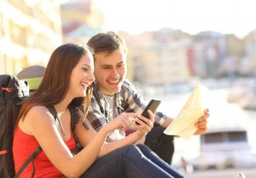 Young Couple Traveling Using Phone App