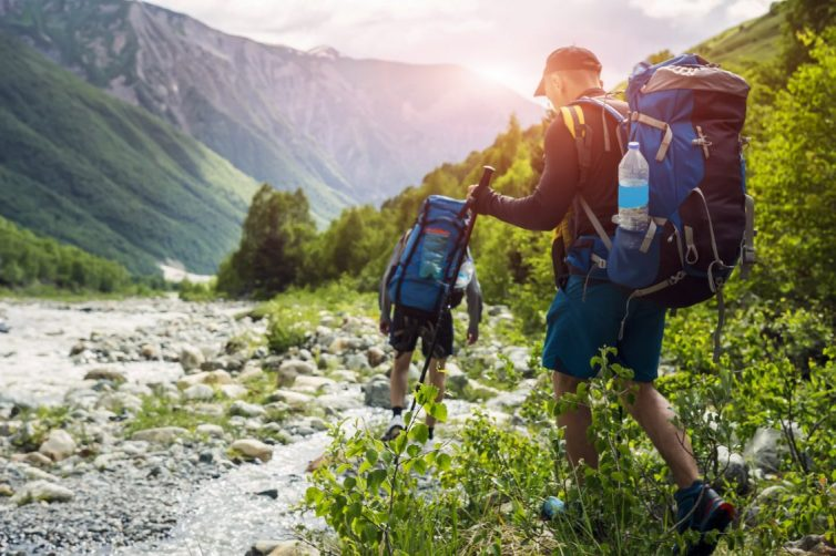 Two Men Hiking With Backpacks
