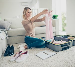 Women planing and packing suitcase for holiday