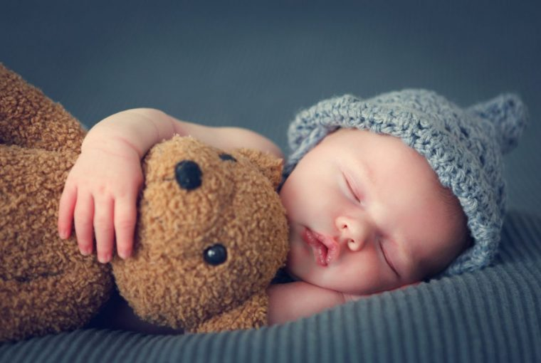 Baby With Grey Hat And Teddie Bear