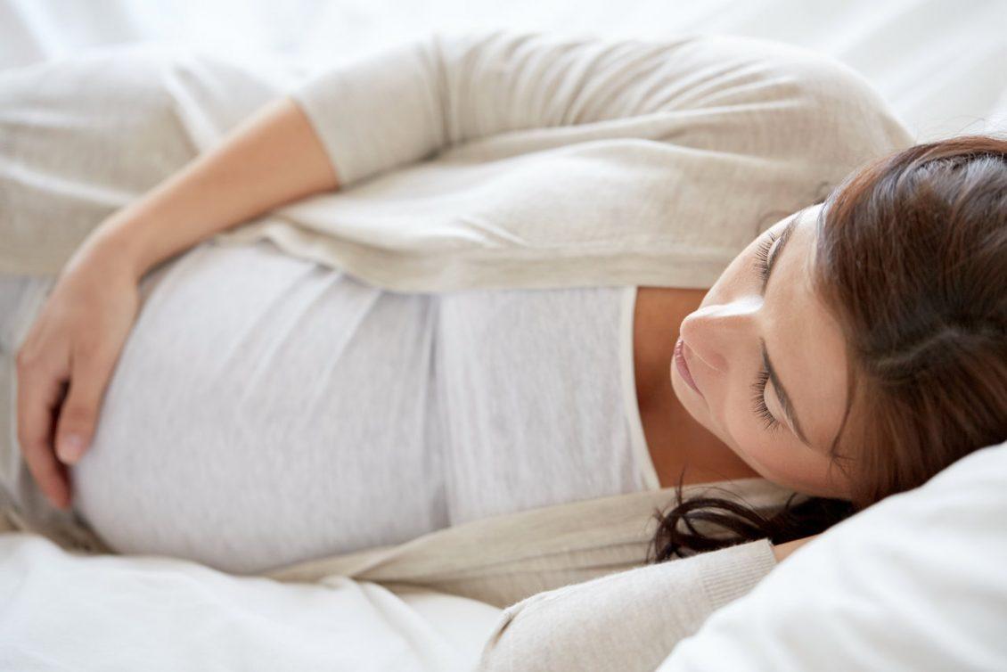 Pregnant women sleeping on her left.