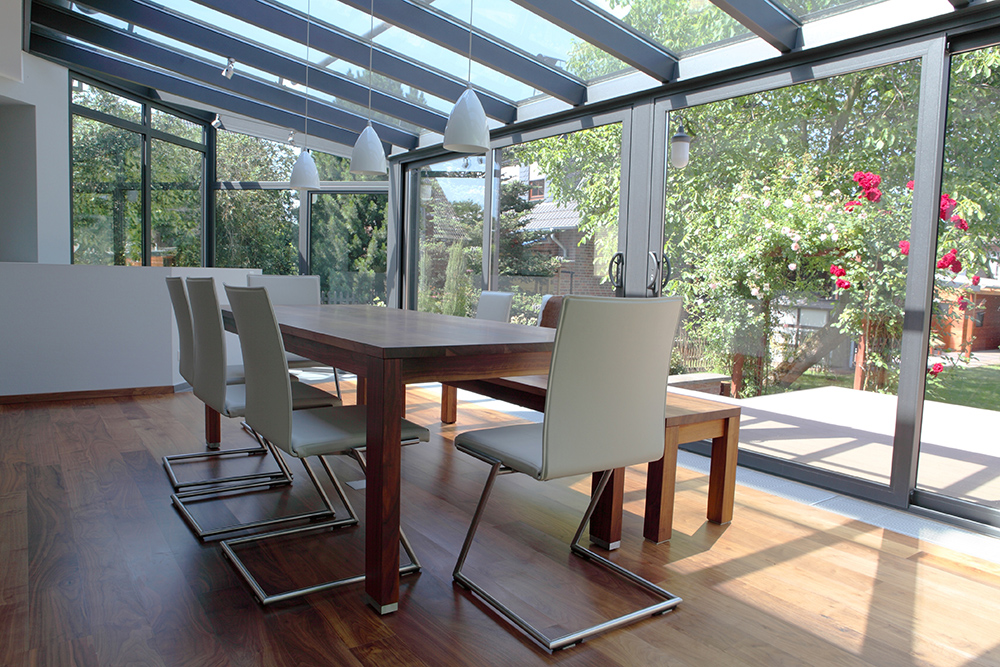 Conservatory with dining table and chairs