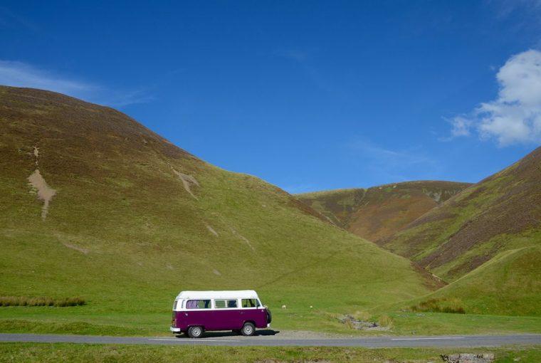 Purple VW camper van in the hills of Scotland