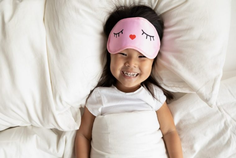 Happy girl in bed