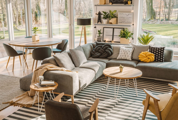 Nordic living room interior with large cosy grey corner sofa