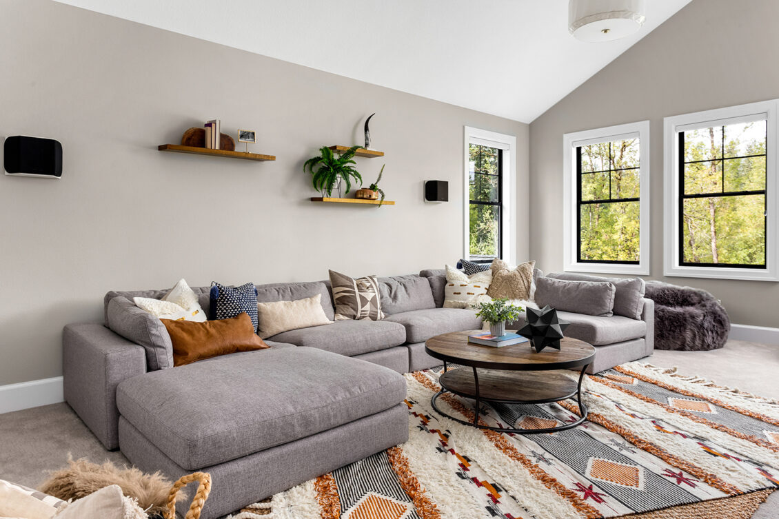 Grey large corner sofa in cosy living room