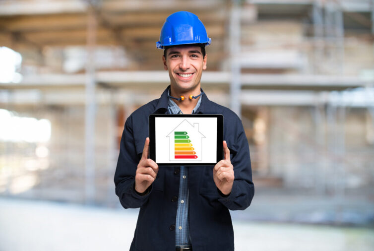 Man in hard hat holding tablet with EPC rating