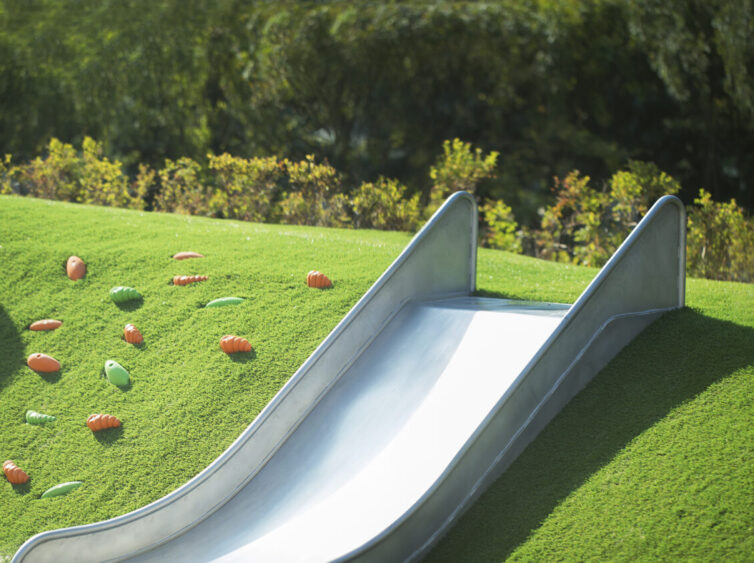 Synthetic grass kids placy area and slide