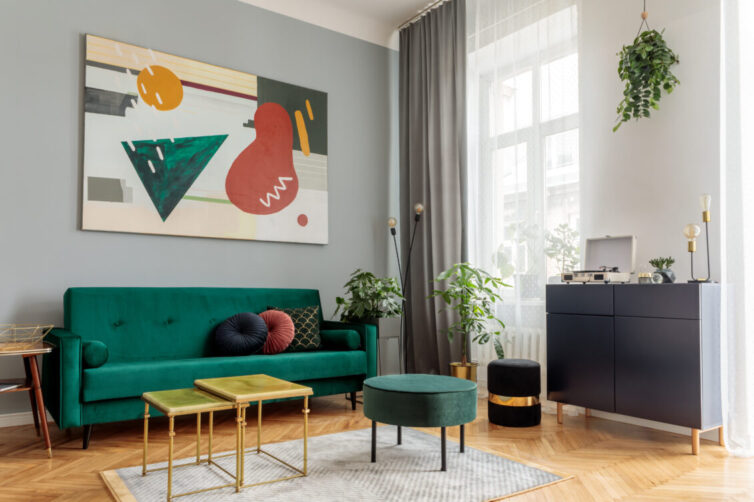 Living room with parquet flooring and green velvet sofa