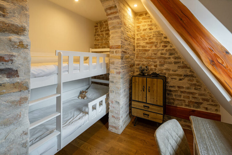 Bunk bed built in to loft wall space