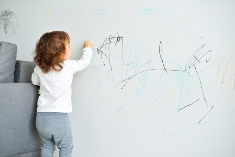 Child drawing on lounge wall