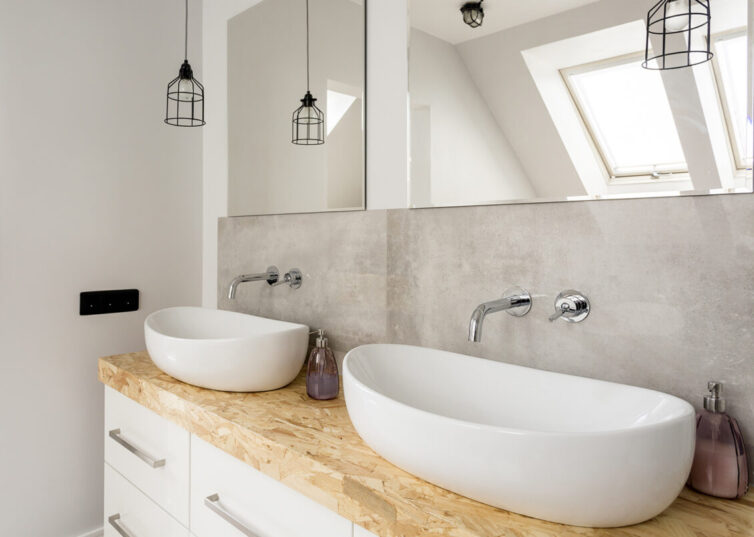 Bathroom with two sinks and mirrors