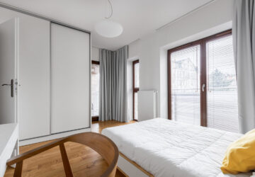 Bedroom with white sliding wardrobe doors