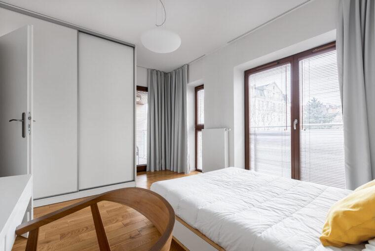 Bedroom with white sliding wardrobe doors