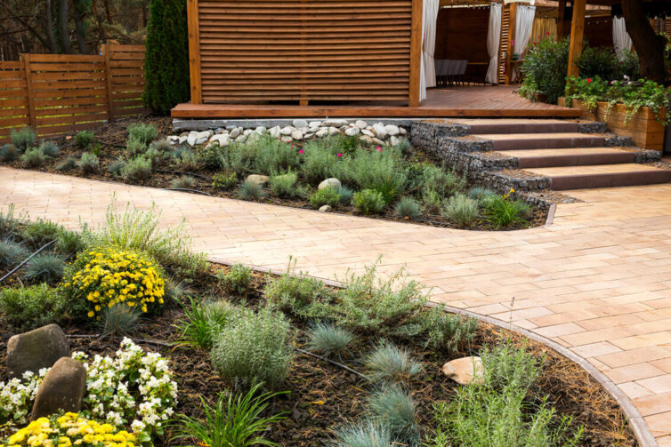 Stone path and flower beds in garden