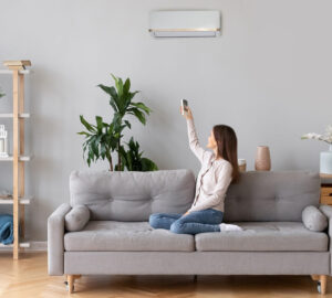 Women sitting on sofa using air conditioning