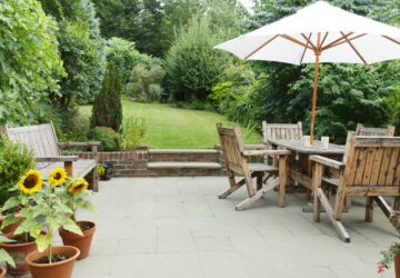 Garden with pathed patio and wooden patio furniture