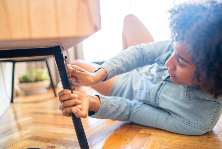 Women mending chair