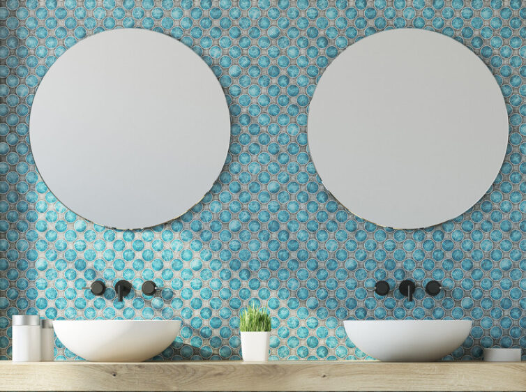 Bathroom with double sink and mirror with blue circular tiles