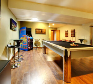 Games room with pool table and arcade game