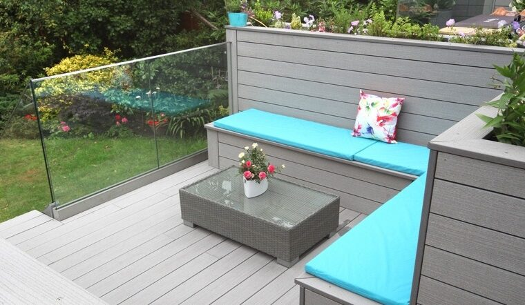Grey composite decking and seating with blue cushioning