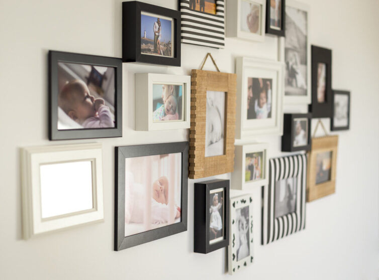 Family photographs in frames on the wall
