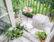 Balcony with cushion, plants and table