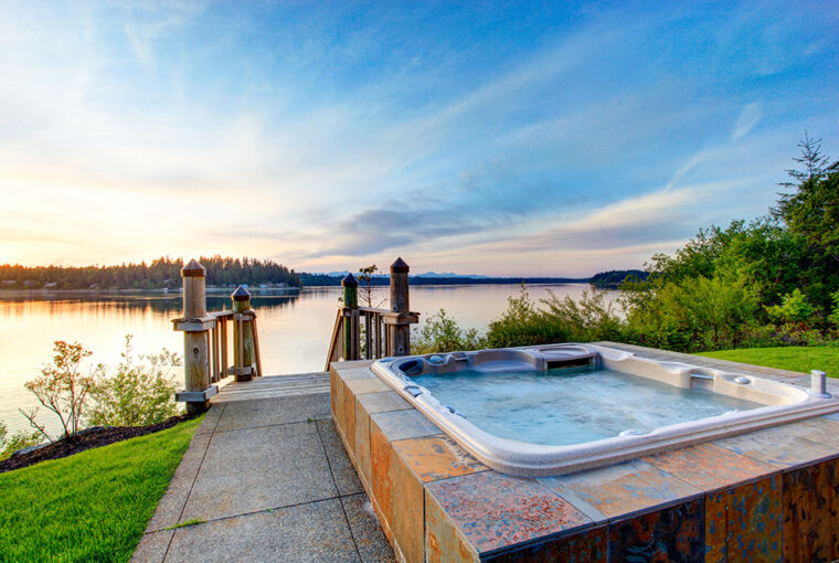 Hot tub in garden with sea views