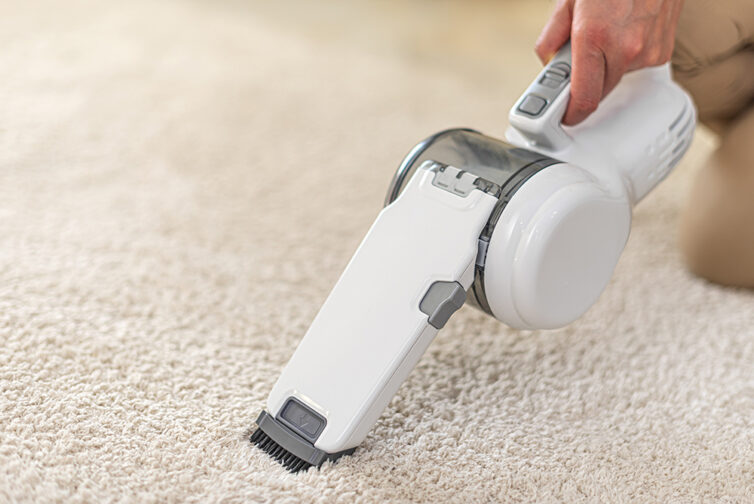 Portable Vacuum Cleaner being used on cream carpet