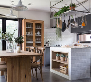 Eclectic Kitchen with real wood table and cupboard, ,metal hanging shelves and modern kitchen cabinets